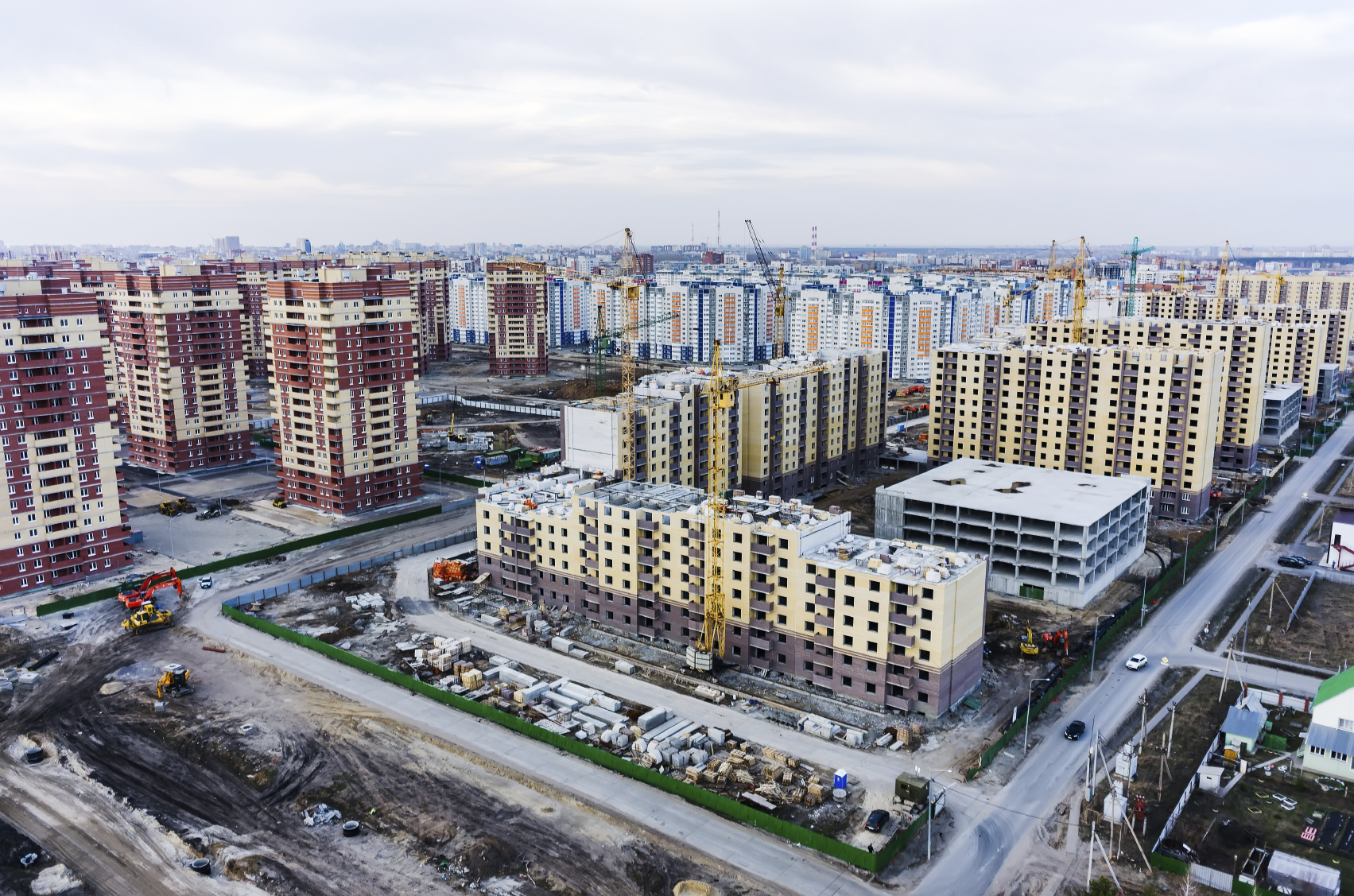 Aerial view on lifting cranes on construction site of residential house in Tyumen, Russia