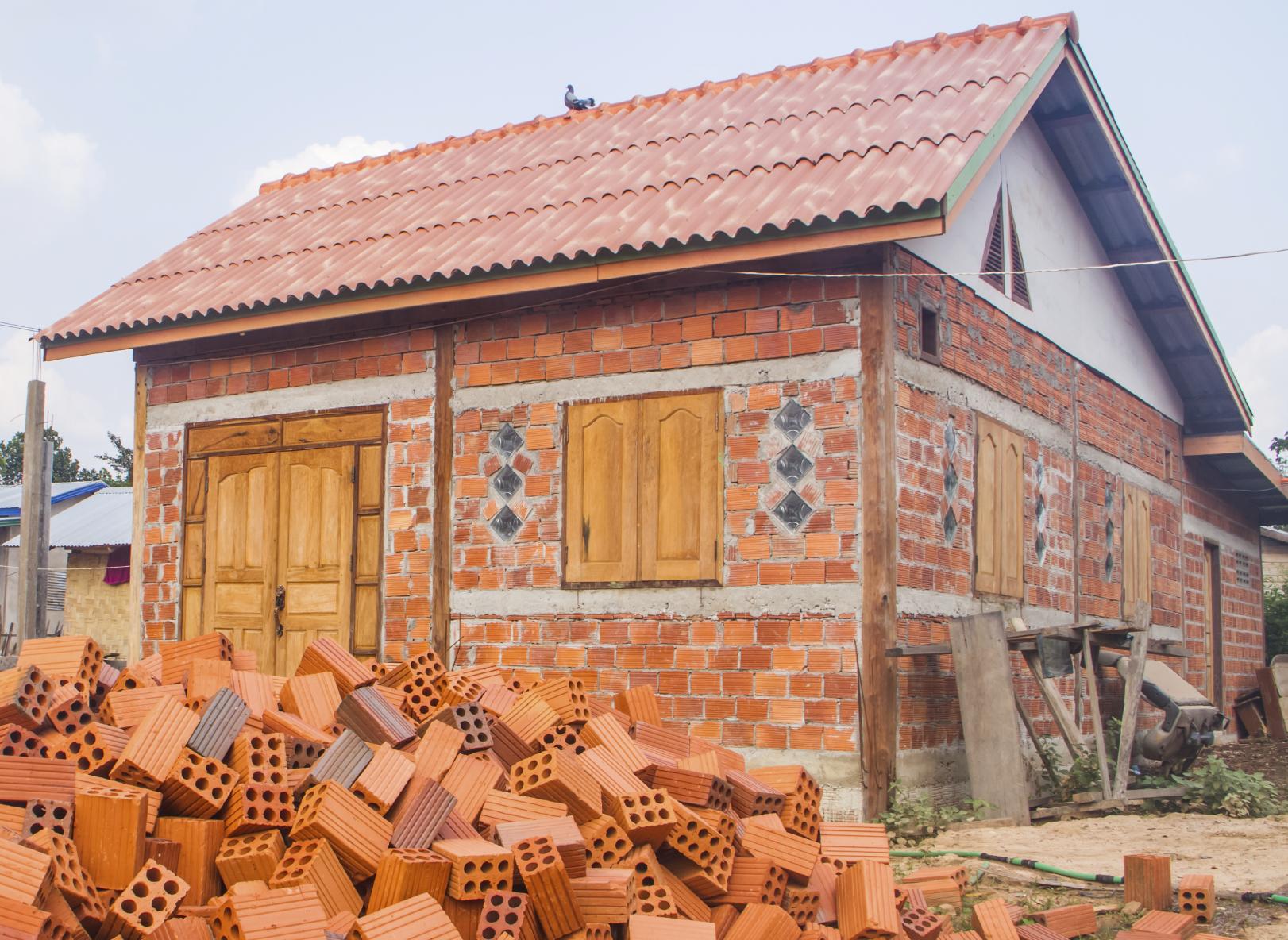 Building house with adobe bricks.