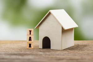 How to calculate tax liability for vacant house property?